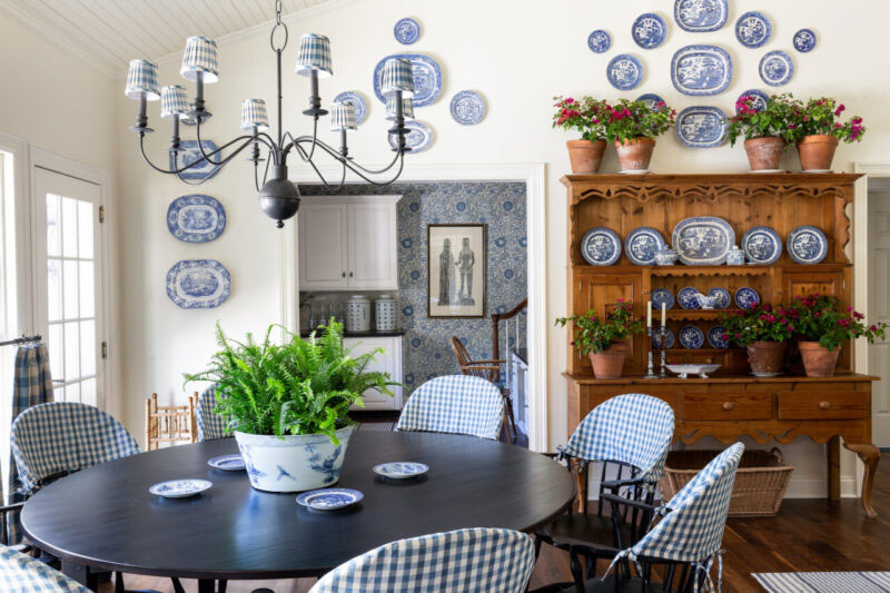 Blue check slipcover toppers on dining chairs.