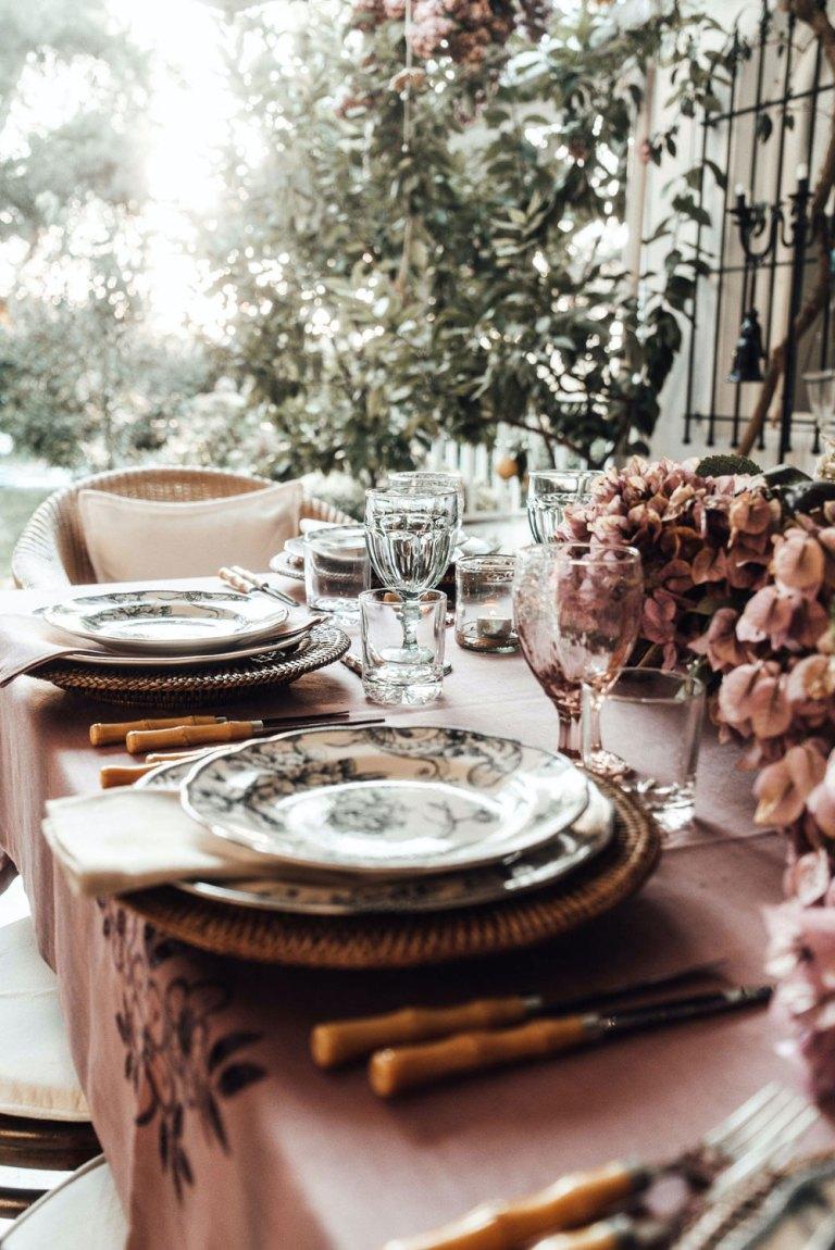 Dining table set for outside dinner.