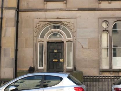 The door has an unusual decoration surrounding it.