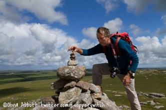 Graham carefully adds another stone to the cairn