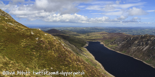 Looking along Llyn Cowlyd Reservoir and way out to sea