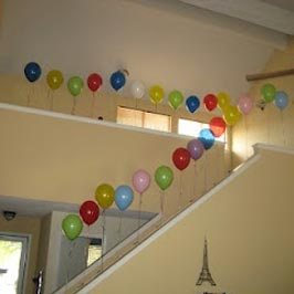 path made of balloons to the gift