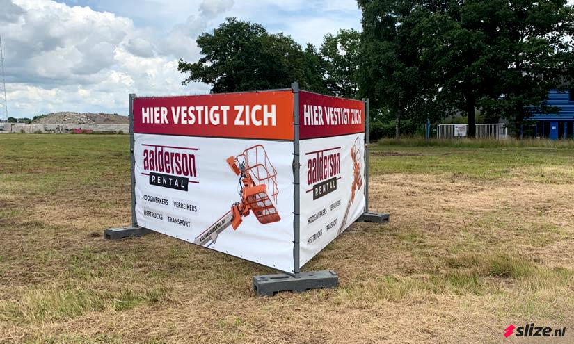 Twee bouwhek spandoeken printen voor Aalderson Rental in Enschede