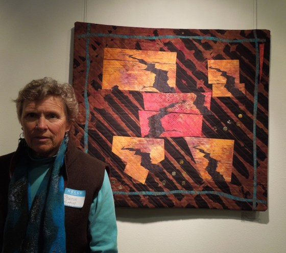 "Sharon Emerson with her Art Quilt, ""Tectonic Trysts"""