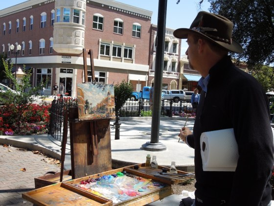 Thomas Van Stein looks over his entry in the Plein Art Quick Draw