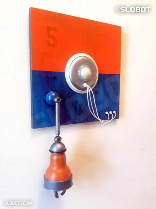 Mike Slobot Robot Painting Number 5 in Orange, Blue, and Violet from Left