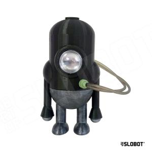 """Carl 5 mk 3 is a small robot sculpture designed and printed by robot artist Mike Slobot as part of his robot universe """"The Slobots"""". The Carl 5 series are robot plumbers and can be found on many interstellar cruise ships. Stands about 4″ tall. This is custom finished in """"Slobot Ranger"""" with an army green top and silver bottom. Also has a chrome eye and grey wires. z"""