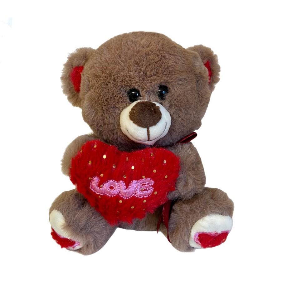 Plišani medo sa srcem i natpisom LOVE veličine 17 centimetara. Prekrasni smeđi medo sa crvenim srcem na koiem je velikim slovima napisano LOVE.