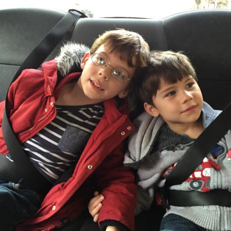 Isaac and Toby in a black cab
