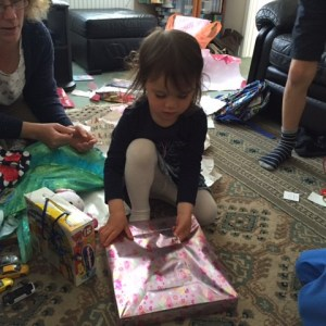 Kara unwrapping presents