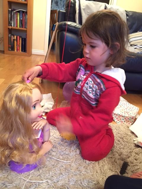 Kara brushing hair