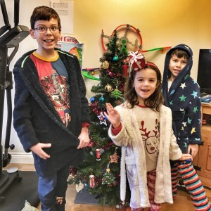 Kids ready for Christmas with Christmas tree and decorations