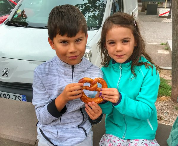Toby and Kara eating a giant pretzel