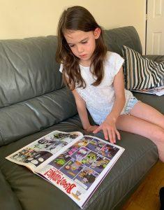 A girl reading a comic