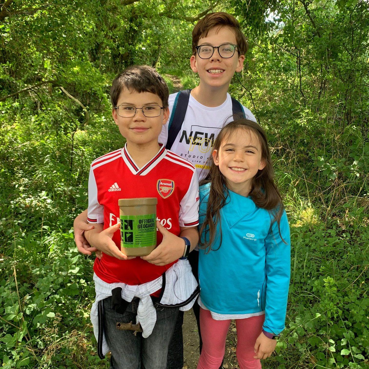 Three children geocaching