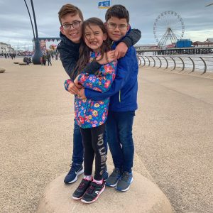 Three children hugging