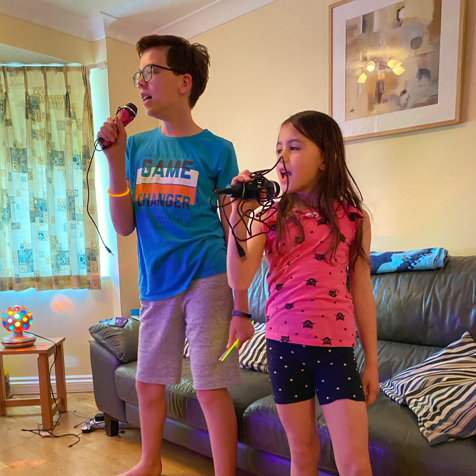 A boy and a girl singing karaoke