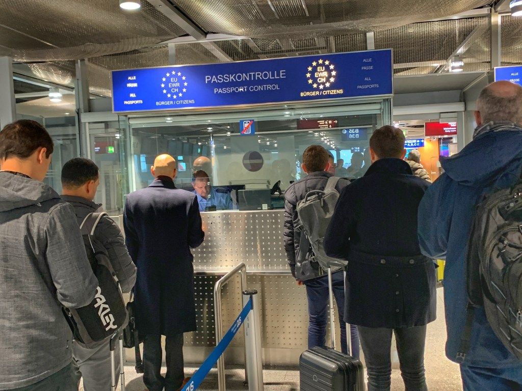 A queue of people at passport control at an airport