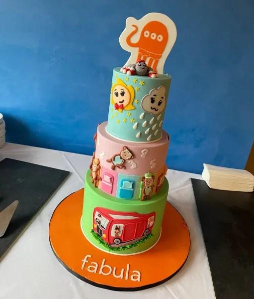 A three-tier multi-coloured cake