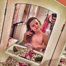 Kara brushing hair mirror