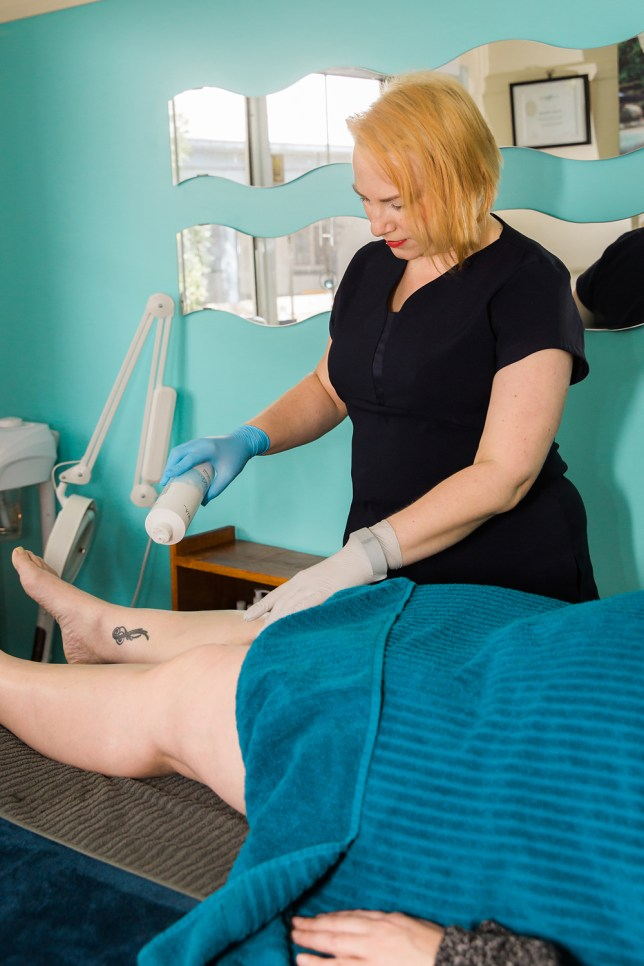 Professional Sugaring Practitioner, preparing the client's skin for service with the Vertal 6 Drying Powder