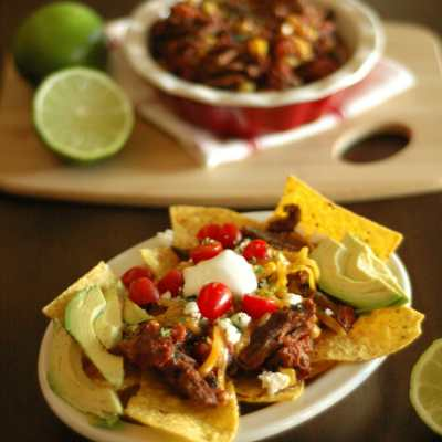 Slow Cooker Chipotle Beef Nachos with Roasted Corn and Tomatoes