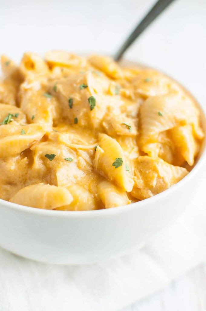 Slow Cooker Buffalo Chicken Mac and Cheese in a white bowl with a white napkin