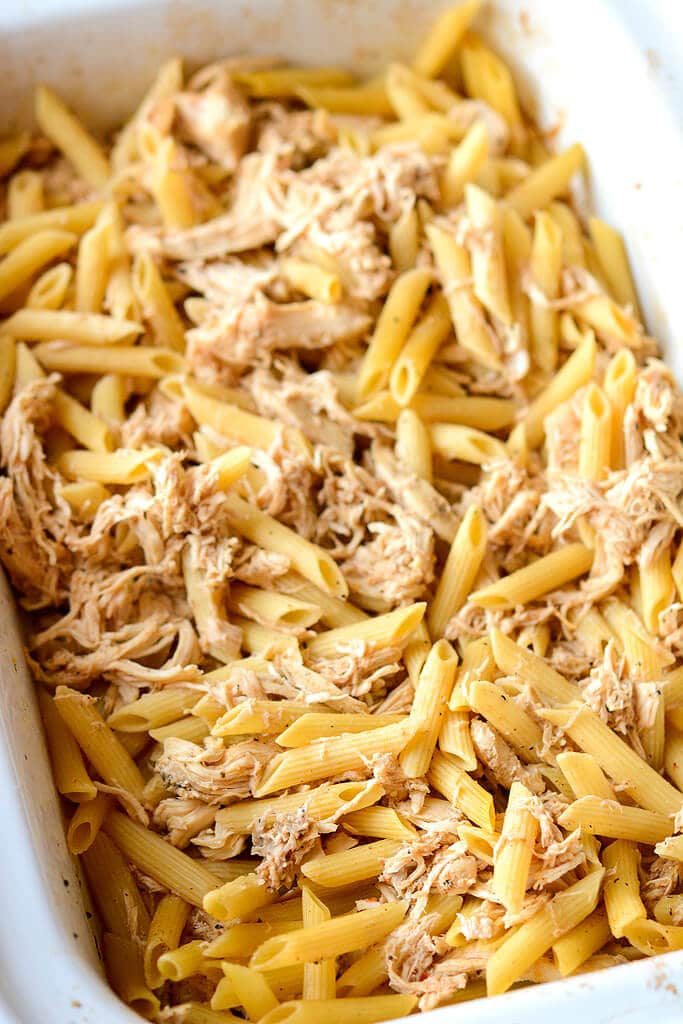 Pasta and chicken in a baking dish - Slow Cooker Chicken White Cheddar Bacon Mac