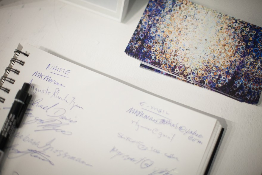Stoltzfus Studio guestbook with show postcards - photo credit SteveMcFarland