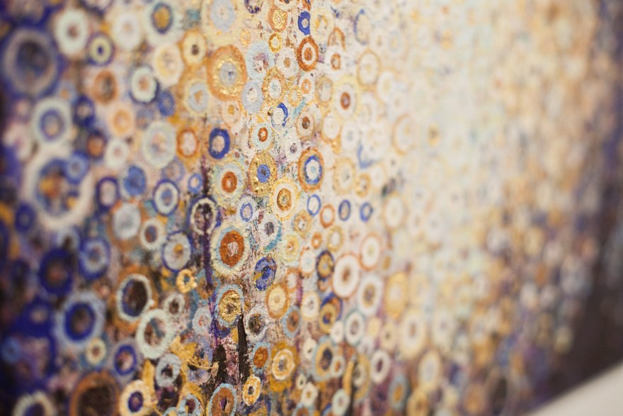 Gold leaf details float in field of yellow and blue circles in the painting Near by artist Randall Stoltzfus