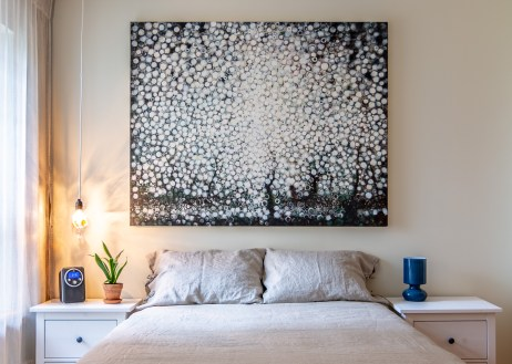 "The painting ""Bare"" by Randall Stoltzfus hangs over the bed in the artist's Brooklyn apartment"