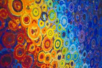 Color Transitions | Circles in red, orange, yellow, blue, and violet in a detail photos of the painting Omega by Brooklyn artist Randall Stoltzfus