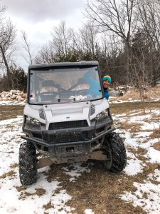 a smiling guy in a quad with snow