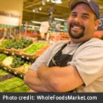 Whole Foods Market produce section and employee