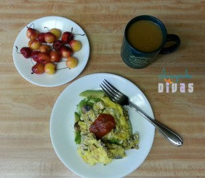 color photo of a plate with scrambled eggs, another plate of Rainier cherries, and a cup of coffee
