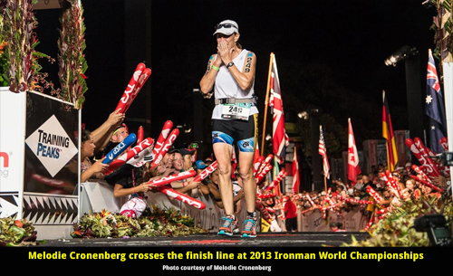 Color photo of Melodie Cronenberg crossing the finish line at the 2013 Ironman World Championships