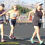 Color photo of three female power walkers aged 50 and over at 2015 Huntsman World Senior Games