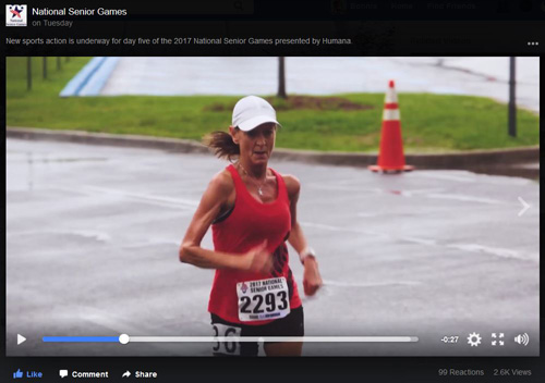 Screenshot from the 2017 National Senior Games' video showing a woman competing in 5K race walk.