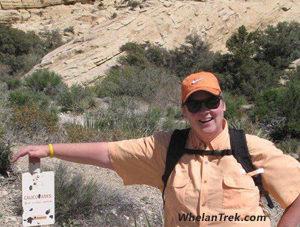Karen Whelan posing at Calico Tanks trail head marker