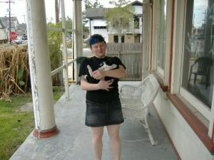 Me & Runty, one of the cats, on our porch. God I'm going to miss that house.