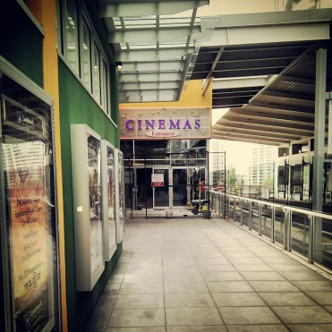 A cinema right next to the tracks: New Westminster Skytrain Station (Source: Flickr Dennis S. Hurd)
