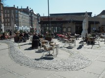 This cafe patio achor's and activates Copenhagen's Super Kilen.