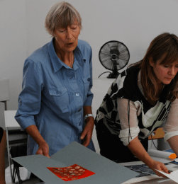 June Mendez and Emma Neuberg looking through the late Theo Mendez portfolio, Slow Textiles Group event