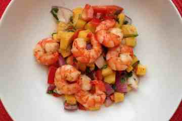 Pan fried prawns on a spicy mango salsa