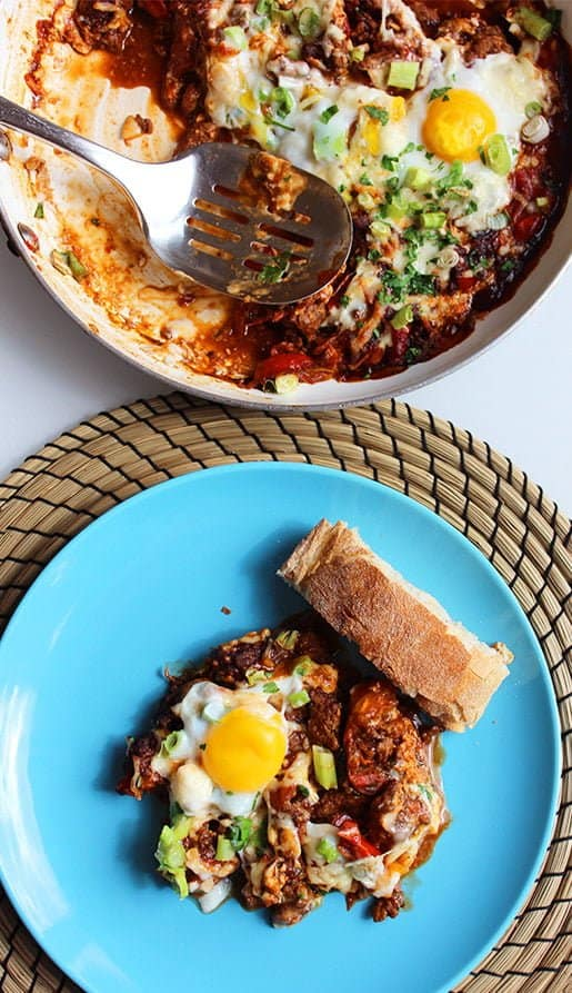 A mexican inspired brunch made for sharing! Spicy beef and cheese are mixed in a tomato sauce and topped with perfectly runny eggs