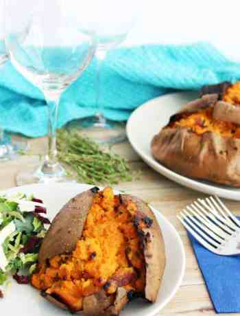 Twice baked stuffed sweet potatoes on a plate with salad