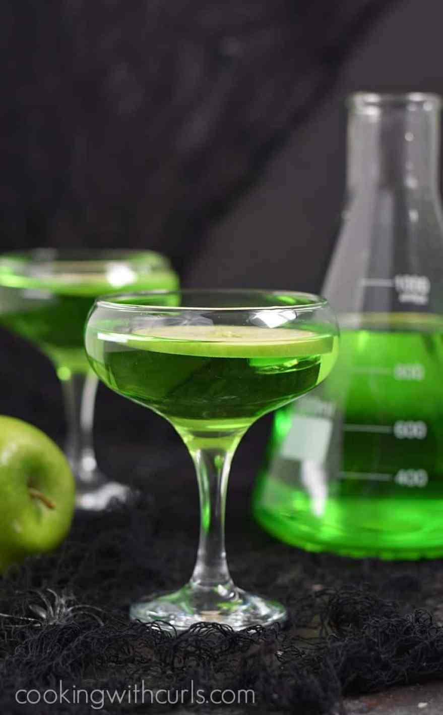 A poisoned apple cocktail in a shallow cocktail glass