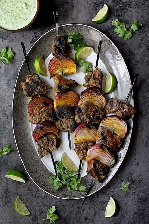 beef kabobs on a serving platter