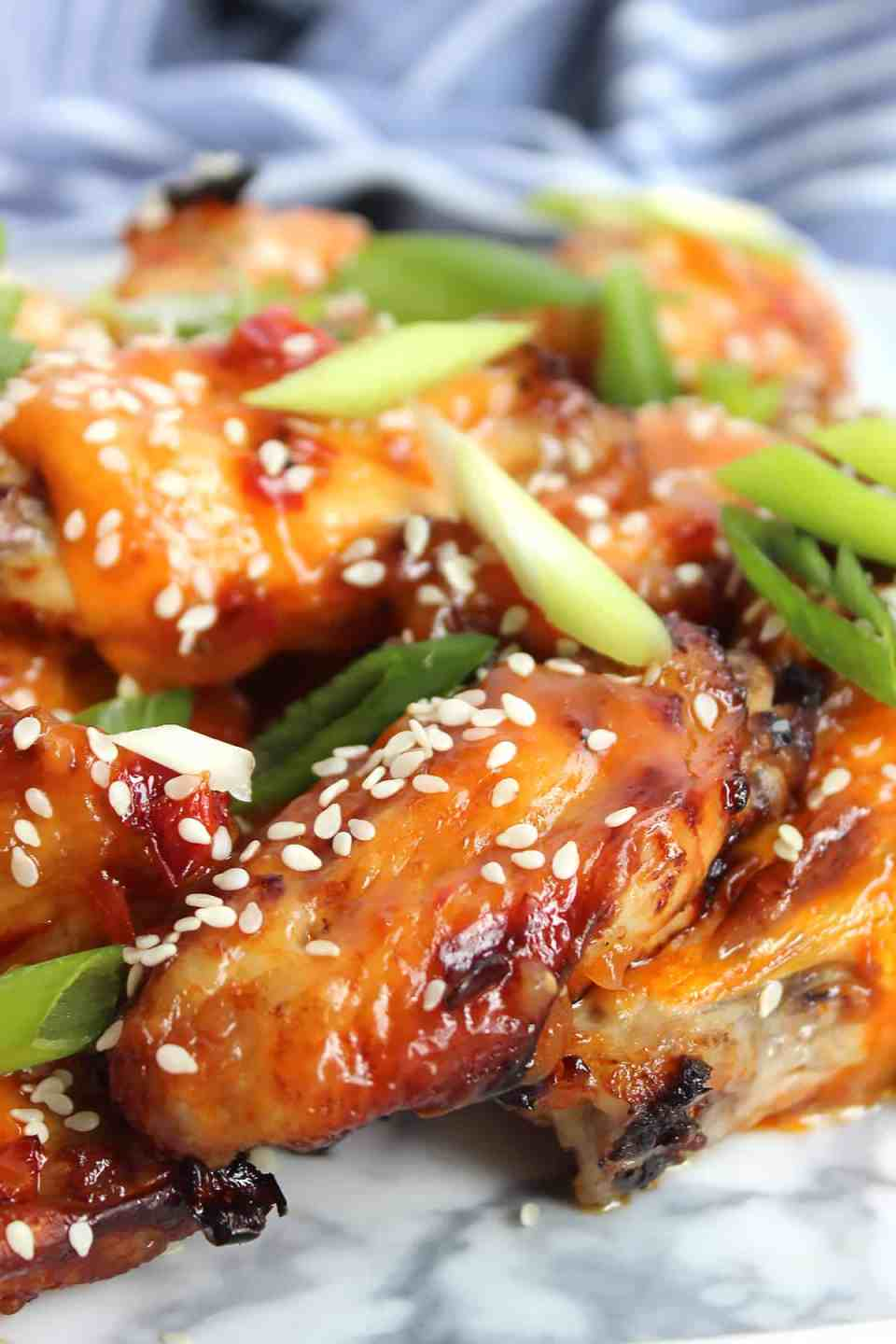 Chili and pineapple wings piled on top of each other