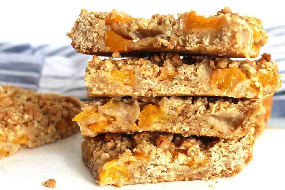 Peach oatmeal bars stacked on top of each other